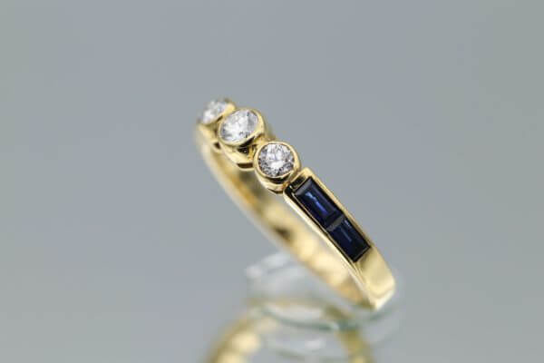 Yellow diamodn ring with sapphire side stones